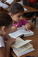 Morocco, Casablanca - soukoth fest, young jewish girls, reading in the synaguogue. the jewish girls school, lubavitch  Ohale Yosseg Ytshak oufaratsta .  /  fete de soukoth . fete des cabanes , jeunes filles lisant des livres religieux dans la synaguogue , ecole loubavitch , casablanca, maroc / +
