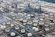 "Exxon Mobil's Beaumont refinery sits approximately 6 feet above sea level. The Union of Concerned Scientists has raised concerns that this and other coastal refineries are vulnerable to storm surge and sea level rise. The group warned of ""danger to employees, releases of environmental contamination, disruption in supply chains and distribution centers, and/ or power supply."" Inundation during Hurricane Katrina  closed this plant temporarily."