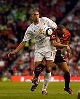 Fotball<br /> England 2005/2006<br /> Foto: SBI/Digitalsport<br /> NORWAY ONLY<br /> <br /> Manchester United v Debrecen VSC. UEFA Champions League Qualifier.<br /> 09/08/2005.<br /> <br /> Debreceni's Zsombor Kerekes (L) holds off Manchester United's Mikael Silvestre