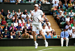 Kyle Edmund in action against Jaume Munar on day one of the Wimbledon Championships at the All England Lawn Tennis and Croquet Club, Wimbledon.