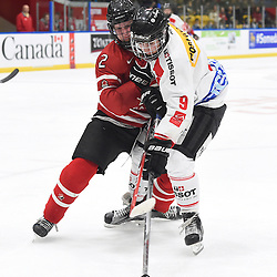 WHITBY, - Dec 13, 2015 -  WJAC Game 2- Team Switzerland vs Team Canada East at the 2015 World Junior A Challenge at the Iroquois Park Recreation Complex, ON. Fabian Berni #9 of Team Switzerland battles for control with Owen Grant #2 of Team Canada East during the second period.<br /> (Photo: Andy Corneau / OJHL Images)