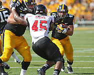 August 31 2013: Iowa Hawkeyes running back Mark Weisman (45) looks to get around the end on a run during the second quarter of the NCAA football game between the Northern Illinois Huskies and the Iowa Hawkeyes at Kinnick Stadium in Iowa City, Iowa on August 31, 2013. Northern Illinois defeated Iowa 30-27.
