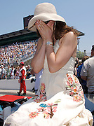 Ashley Judd hides her face as husband Dario Franchitti finishes his qualification run putting him on the provisional pole position for the Indy 500 on May 12, 2007. Photo by Michael Hickey