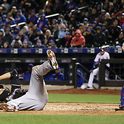 NEW YORK, NEW YORK - APRIL 12: Giancarlo Stanton, Miami Marlins, avoids a high pitch from Jim Henderson, New York Mets, as catcher Travis d'Arnaud  looks on during the Miami Marlins Vs New York Mets MLB regular season ball game at Citi Field on April 12, 2016 in New York City. (Photo by Tim Clayton/Corbis via Getty Images)