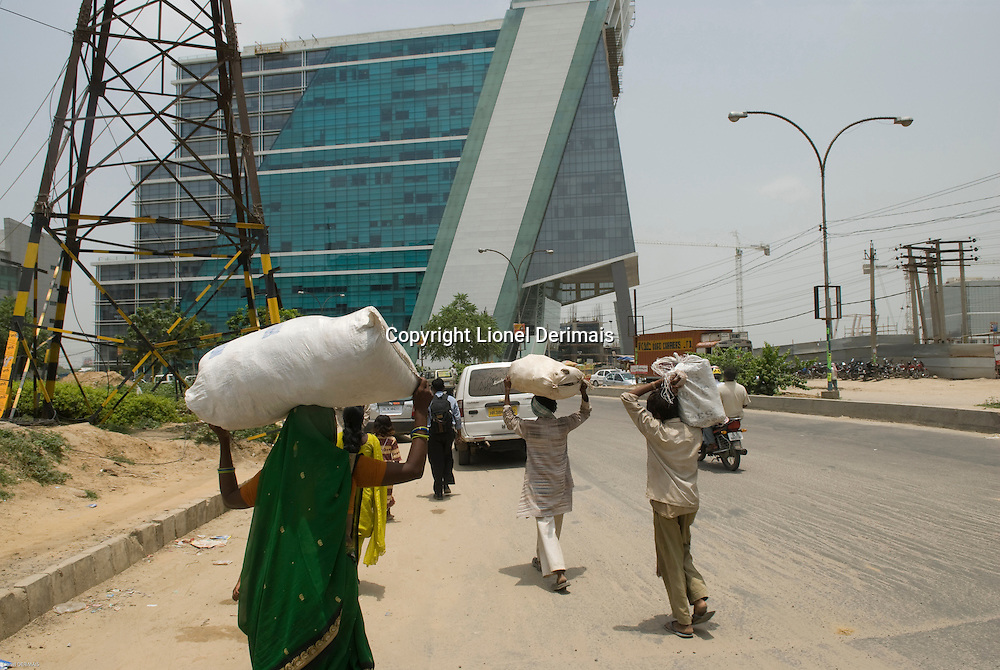 Day laborers arrive in Gurgaon, New Delhi's new CBD, an hour South of the city.