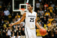 November 24th, 2013:  Colorado Buffaloes junior guard Spencer Dinwiddie (25) looks for a pass before attempting a 3 point shot in the second half of the NCAA Basketball game between the Harvard Crimson and the University of Colorado Buffaloes at the Coors Events Center in Boulder, Colorado