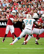 Sept. 30, 2012; Glendale, AZ, USA; Arizona Cardinals quarterback Kevin Kolb (4) makes a pass in the first half against the Miami Dolphins at University of Phoenix Stadium. Mandatory Credit: Jennifer Stewart-US PRESSWIRE.