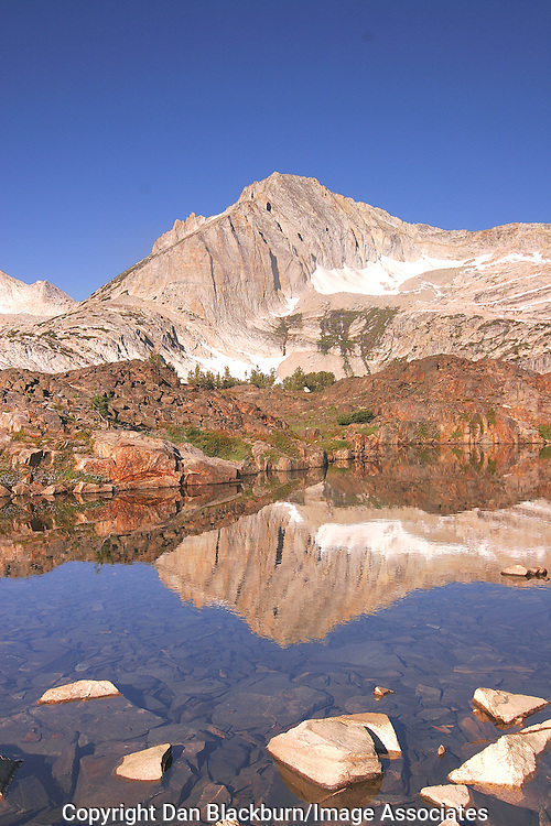 North Peak is reflected in a mountain tarn in the Hoover Wilderness of the Sierra Nevada.