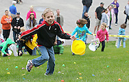 Braiden Groff, 6, of Cedar Rapids runs up the hill during the Church Easter Egg Hunt at Hillside Wesleyan Church, 2600 1st Ave NW, in Cedar Rapids on Saturday morning, March 31, 2012. This year there were over 7,500 eggs up for grabs. (Stephen Mally/Freelance)