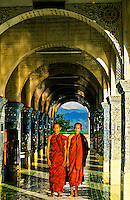 Monks walking through the aches at Sutaungpyi Pagoda on top of Mandalay Hill, Mandalay, Burma (Myanmar)