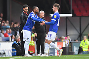 Substitution Oldham Athletic forward  Callum Lang (19) comes off and Oldham Athletic midfielder Gevaro Nepomuceno (27) goes on during the EFL Sky Bet League 2 match between Grimsby Town FC and Oldham Athletic at Blundell Park, Grimsby, United Kingdom on 15 September 2018.