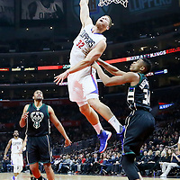 16 December 2015: Los Angeles Clippers forward Blake Griffin (32) goes for the dunk over Milwaukee Bucks forward Giannis Antetokounmpo (34) during the Los Angeles Clippers 103-90 victory over the Milwaukee Bucks, at the Staples Center, Los Angeles, California, USA.
