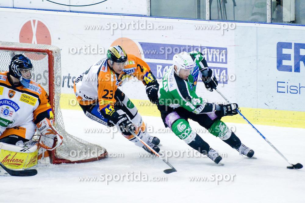 Matej Hocevar (HDD Tilia Olimpija, #14) vs Florian Iberer (Moser Medical Graz 99ers, #23) during ice-hockey match between HDD Tilia Olimpija and Moser Medical Graz 99ers in 43rd Round of EBEL league, on Januar 28, 2011 at Hala Tivoli, Ljubljana, Slovenia. (Photo By Matic Klansek Velej / Sportida.com)