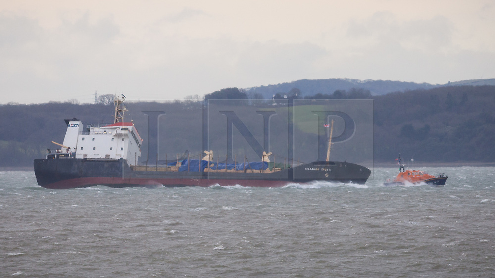 © Licensed to London News Pictures. 27/12/2017. Lee-on-Solent, UK.  Bembridge Lifeboat on standby at the stricken Russian cargo vessel, Mekhanic Yartsev this morning as the Maritime and Coastguard Agency formulate a plan to move her to Southampton. 13 crew members were rescued yesterday when the vessel developed a list, so made her way into the sheltered waters of The Solent before the weather conditions deteriorated. Photo credit: Rob Arnold/LNP