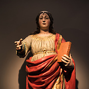 A guilded wood statue of Saint Catherine (Santa Catarina) by a Portuguese sculptor dating to the 17th or 18th century. The Museu de São Roque is a museum attached to the the Igreja de Sao Roque to display various historical religious artefacts from the church. The 16th century Igreja de São Roque was one of the earliest Jesuit churches in Christendom and features a series of ornately decorated Baroque chapels.