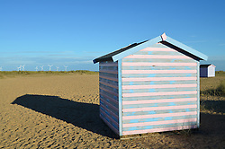Beach huts near Great Yarmouth - Scroby Sands windfarm in the background. 2014