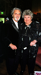 MR DESMOND RAYNER and his wife, agony aunt CLAIRE RAYNER, at a ball in London on 5th February 2000.OAW 16