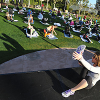 Fitness trainer Jillian Michaels conducts the morning workout during the Clinton Foundation's Health Matters Conference at the Renaissance Esmeralda Indian Wells Resort & Spa in Indian Wells, Calif., during the Humana Challenge week, Tuesday, January 17, 2012. (Eric Reed/AP Images for Humana)