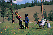 Children fetching water<br /> Lake Hovskol<br /> Mongolia