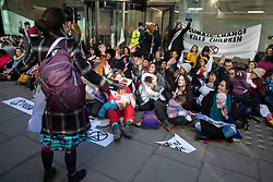 London, UK. 2 December, 2019. Climate activist mothers from XR Families nurse their babies outside the headquarters of the Labour Party as part of a roving nurse-in outside the premises of the various political parties to demand that they put the climate and ecological emergency at the heart of their general election campaigns.