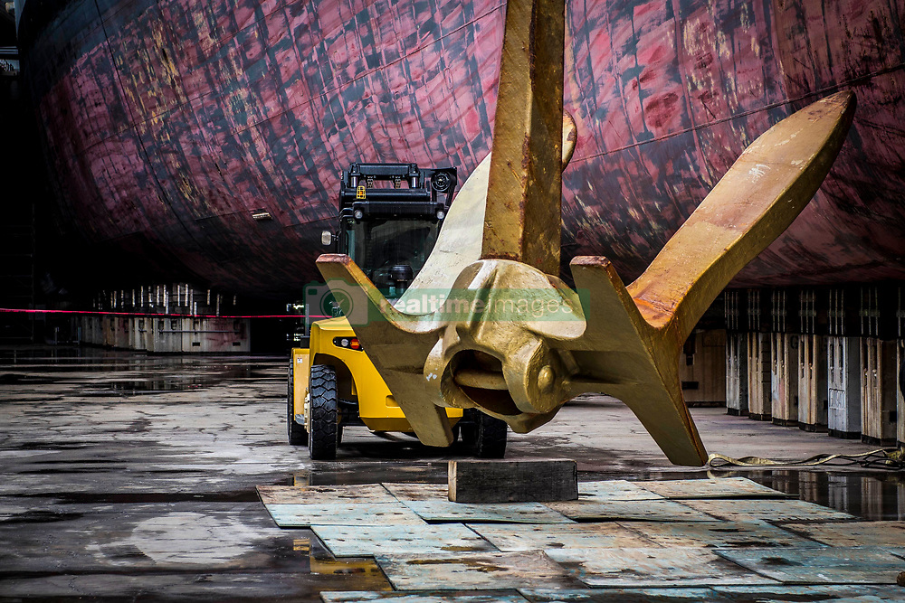 March 15, 2019 - Portsmouth, Virginia, U.S. - The starboard anchor aboard the aircraft carrier USS George H.W. Bush (CVN 77) is lowered into a dry dock for maintenance. George H.W. Bush is currently in Norfolk Naval Shipyard for its docking planned incremental availability. (Credit Image: © U.S. Navy/ZUMA Wire/ZUMAPRESS.com)
