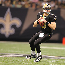 Dec 27, 2009; New Orleans, LA, USA;  New Orleans Saints quarterback Drew Brees (9) looks to throw against the Tampa Bay Buccaneers during the first quarter at the Louisiana Superdome. Mandatory Credit: Derick E. Hingle-US PRESSWIRE..