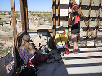 """High Desert Test Sites 2013, Eames Demetrios, """"Kcymaerxthaere Story Telling"""" visitors writing stories on the wall"""