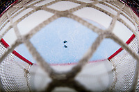 KELOWNA, CANADA - JANUARY 4:  The puck breaks in two pieces and lays on the ice on January 4, 2019 at Prospera Place in Kelowna, British Columbia, Canada.  (Photo by Marissa Baecker/Shoot the Breeze)