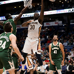 Mar 12, 2019; New Orleans, LA, USA; New Orleans Pelicans center Julius Randle (30) shoots over Milwaukee Bucks guard Tony Snell (21) and guard Pat Connaughton (24) and forward Nikola Mirotic (41) during the second quarter at the Smoothie King Center. Mandatory Credit: Derick E. Hingle-USA TODAY Sports