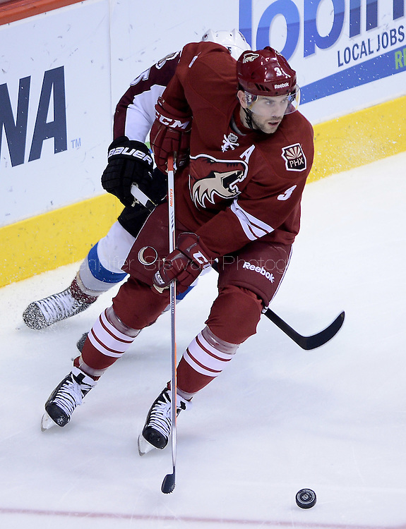 Apr. 6, 2013; Glendale, AZ, USA;  Phoenix Coyotes defenseman Keith Yandle (3) handles the puck in the first period against the Colorado Avalanche at Jobing.com Arena. Mandatory Credit: Jennifer Stewart-USA TODAY Sports