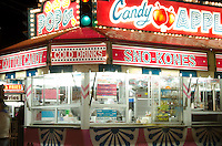 A brightly lit food stall glows after dark at the Blue Hill Fair, Maine.