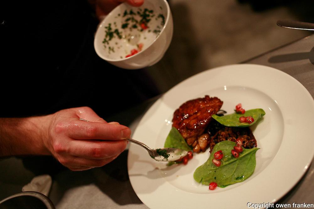 Daniel Rose' restaurant Spring, in Paris..saucing ris de veau (calf sweetbreads)..Photograph by Owen Franken