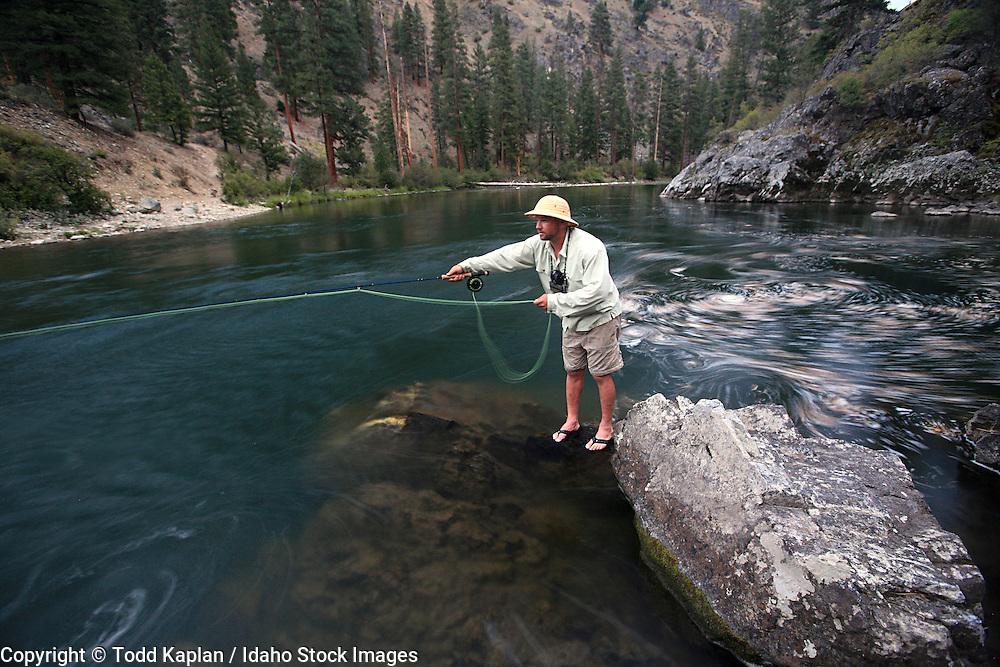 Idaho, Middle Fork Salmon River, Frank Church Wilderness, man, fly fishing, fisherman, water swirling