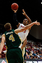 Nov 15, 2011; Stanford CA, USA;  Stanford Cardinal forward/center Josh Owens (13) shoots over Colorado State Rams forward Pierce Hornung (4) during the first half of a preseason NIT game at Maples Pavilion. Mandatory Credit: Jason O. Watson-US PRESSWIRE