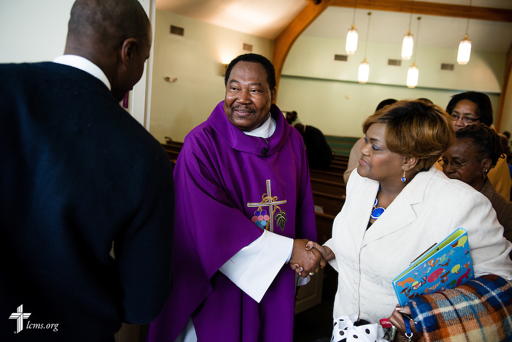 The Rev. Ulmer Marshall greets Valarie Floyd-Bridges (right) following worship at Trinity Lutheran Church on Sunday, April 6, 2014, in Mobile, Ala. LCMS Communications/Erik M. Lunsford