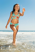 Girl Running in Water