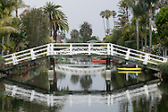 The peaceful Venice canals and the reflection of the bridges that cross the canals in Los Angeles, Californina. Venice, CA 5.1.15