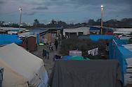 Calais, Pas-de-Calais, France - 22.10.2016    <br />  <br /> So called &rdquo;Jungle&quot; refugee camp on the outskirts of the French city of Calais on the weekend before the scheduled eviction. Many thousands of migrants and refugees are waiting in some cases for years in the port city in the hope of being able to cross the English Channel to Britain. French authorities announced that they will shortly evict the camp where currently up to up to 10,000 people live.<br /> <br /> Das sogenannte &rdquo;Jungle&rdquo; Fluechtlingscamp am Rande der franzoesischen Stadt Calais, am Wochenende vor der angesetzten Raeumung. Viele tausend Migranten und Fluechtlinge harren teilweise seit Jahren in der Hafenstadt aus in der Hoffnung den Aermelkanal nach Gro&szlig;britannien ueberqueren zu koennen. Die franzoesischen Behoerden kuendigten an, dass sie das Camp, indem derzeit bis zu bis zu 10.000 Menschen leben K&uuml;rze raeumen werden. <br /> <br /> Photo: Bjoern Kietzmann
