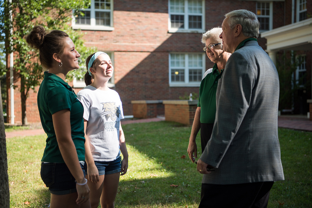 President Nellis and First Lady Ruthie Nellis (Right) greet student employees  Evelyn Gustwiller (Left) and Becca Ryan during move- in Thursday morning. Photo by Ben Siegel