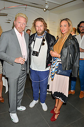 Left to right, BORIS BECKER, GREG WILLIAMS and LILLY BECKER at a private view of woks by German artist Mike Dargas held at the Opera Gallery, 134 New Bond Street, London on 5th July 2016.