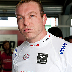 Sir Chris Hoy taking interviews after his first race in the Nissan GT-R, GT3, for team RJN pictured during the first round of the 2014 Avon Tyres British GT Championship at Oulton Park Race Circuit, Cheshire, held on the 21st April 2014.