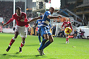 Bristol City forward Jonathan Kodjia and Queens Park Rangers midfielder Karl Henry during the Sky Bet Championship match between Bristol City and Queens Park Rangers at Ashton Gate, Bristol, England on 19 December 2015. Photo by Jemma Phillips.
