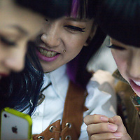 BEIJING, SEPT.30 : A group of young women discusses during a DJ party at School Bar, a  new trendy music venu in Beijing.