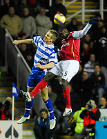 Photo: Leigh Quinnell/Sportsbeat Images.<br /> Reading v Arsenal. The FA Barclays Premiership. 12/11/2007. Arsenals Kolo Toure jumps with Readings Kevin Doyle.