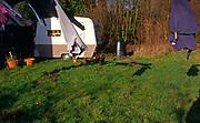 A293K4 Washing line clothes and caravan in country garden Suffolk England