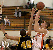 The Beavers Kyle Eakins (14) takes a shot over the Wildcats Brandon Boyd (40) as the Beavercreek Beavers host the Springfield South High School Wildcats Friday night, February 2, 2007.