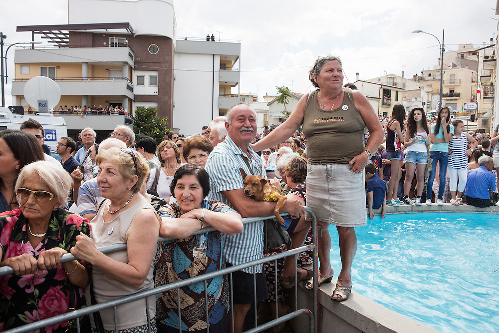 GRASSANO, ITALY - 24 JULY 2014: Local residents wait for Mayor of New York Bill de Blasio to come out of the city hall and come up on stage in Grassano, his ancestral home town in Italy, on July 24th 2014.<br /> <br /> New York City Mayor Bill de Blasio arrived in Italy with his family Sunday morning for an 8-day summer vacation that includes meetings with government officials and sightseeing in his ancestral homeland.