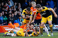 Luke Wilkinson of Luton Town and Lee Minshull of Newport County tussle on the ground during the Sky Bet League 2 match at Kenilworth Road, Luton<br /> Picture by David Horn/Focus Images Ltd +44 7545 970036<br /> 20/12/2014