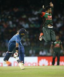 March 16, 2018 - Colombo, Sri Lanka - Bangladesh cricket captain Shakib Al Hasan (2L) leaps in the air as Sri Lanka's Kusal Mendis completes a run during the 6th T20 cricket match of NIDAHAS Trophy between Sri Lanka  and Bangladesh at R Premadasa cricket ground, Colombo, Sri Lanka on Friday 16 March 2018. (Credit Image: © Tharaka Basnayaka/NurPhoto via ZUMA Press)