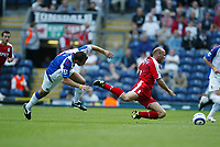 Photo: Peter Phillips.<br /> Blackburn Rovers v Fulham. The Barclays Premiership.<br /> 20/08/2005.<br /> Claus Jensen goes flying after a tackle from Lucas Neill